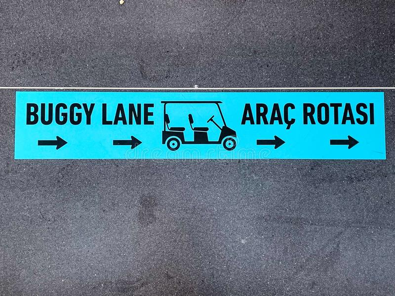 Buggy Lane with a symbol on the floor in English and Turkish language. Path for buggies only, to transport people as free service stock photo