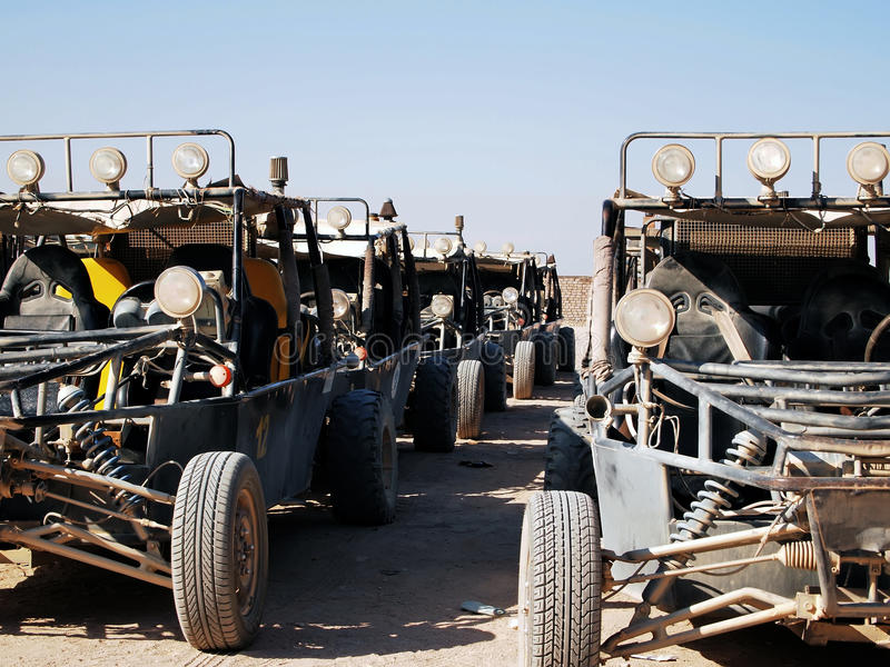 Buggy at the parking. Dusty buggy at the parking in Egyptian desert stock image