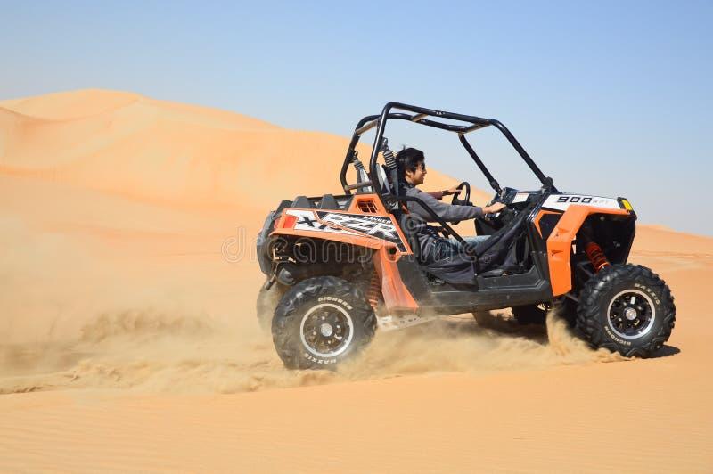 Buggy racing across desert stock image