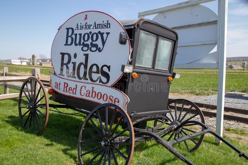 Buggy Rides at the Red Caboose Motel Sign. Ronks, PA, USA - April 23, 2018: The Red Caboose Motel, where guests can stay in vintage cabooses from former stock photography