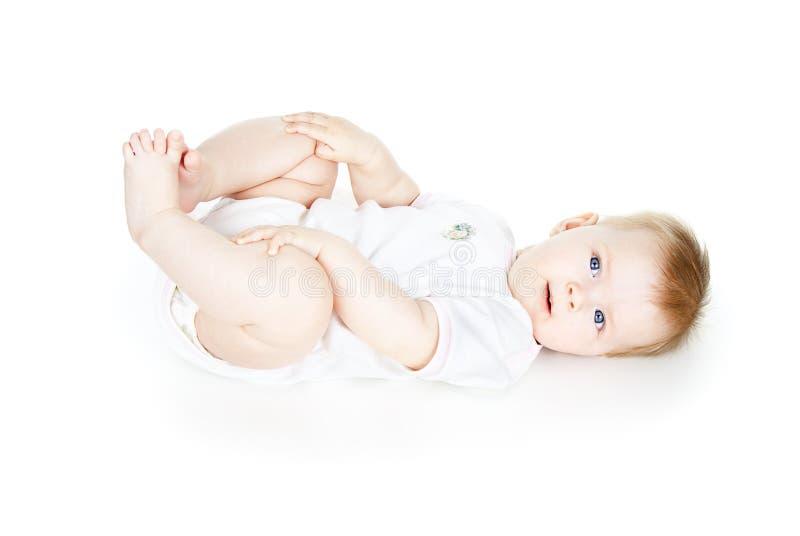 Bugie felici del bambino isolate fotografia stock libera da diritti