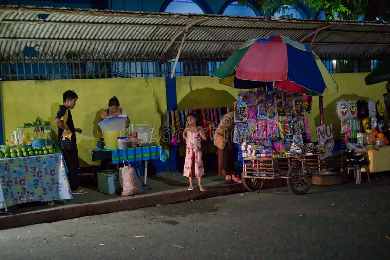 10/16/18 Buglasan Festival Dumaguete Philippines Sassy Girl. A sassy girl showing attitude towards the local street vendors at a night scene during the local royalty free stock photo