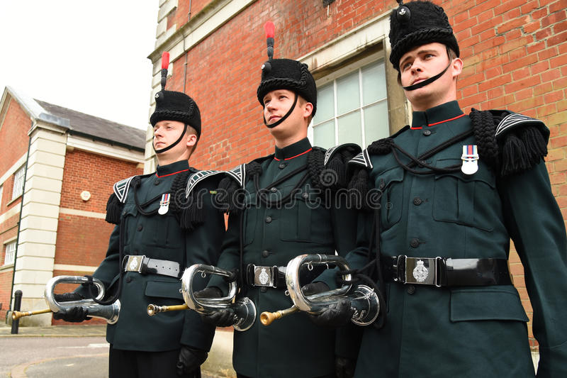 Buglers of the Rifles stand at ease at a military parade royalty free stock images