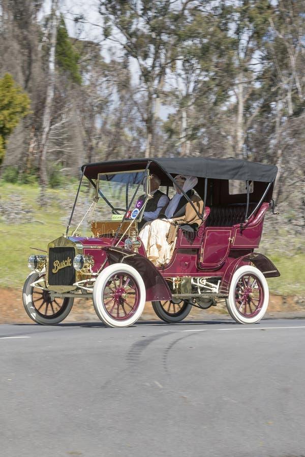 1906 Buick F Tourer. Adelaide, Australia - September 25, 2016: Vintage 1906 Buick F Tourer driving on country roads near the town of Birdwood, South Australia royalty free stock photos
