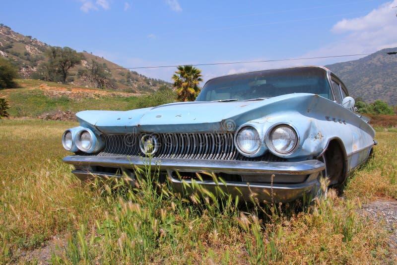 Buick Invicta classic car. SPRINGVILLE, UNITED STATES - APRIL 12, 2014: 1960 Buick Invicta parked in Springville, California. The car manufacturer Buick dates stock photos