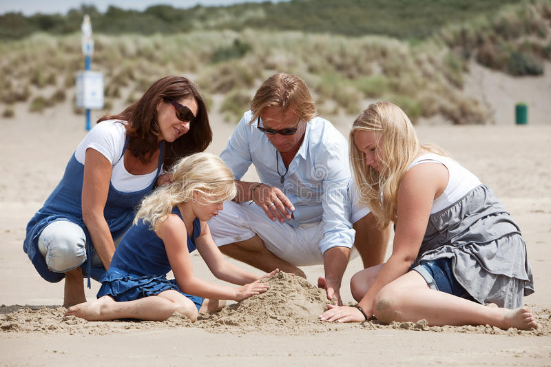 Buidling a sandcastle together royalty free stock photography