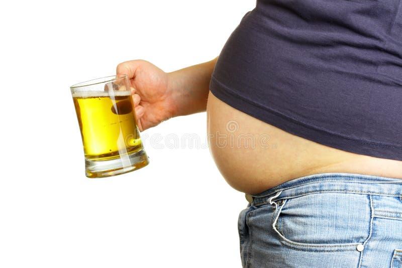 Buik en bier stock afbeeldingen