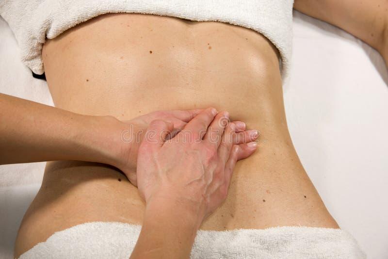 Buik massage stock afbeelding