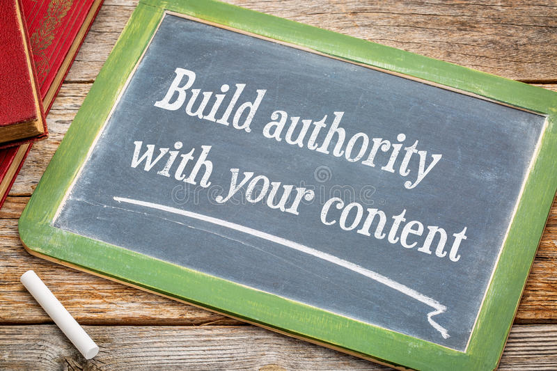 Build authority with your content. Blogging tip - text on a slate blackboard with white chalk royalty free stock image