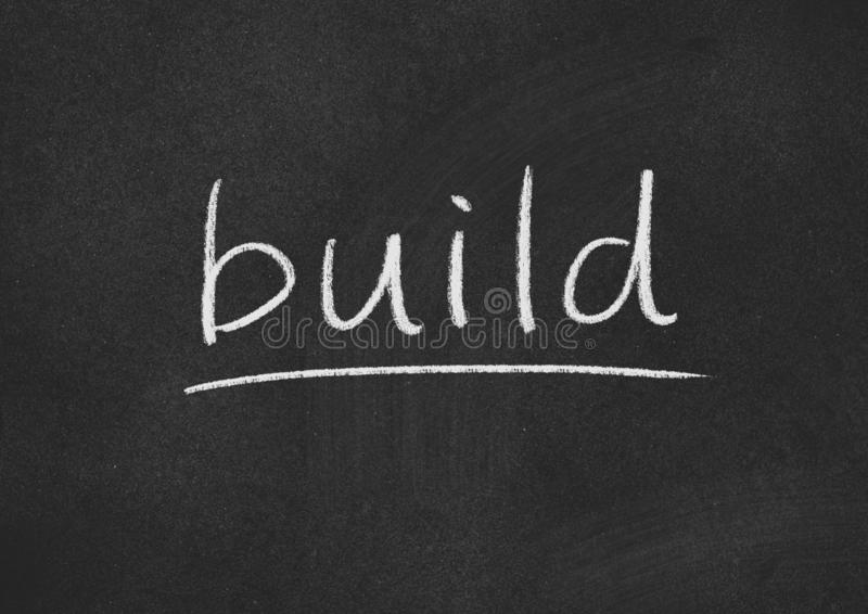 Build. Concept word on a blackboard background royalty free stock images
