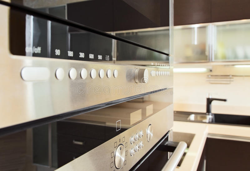 Build in microwave oven in modern kitchen stock images