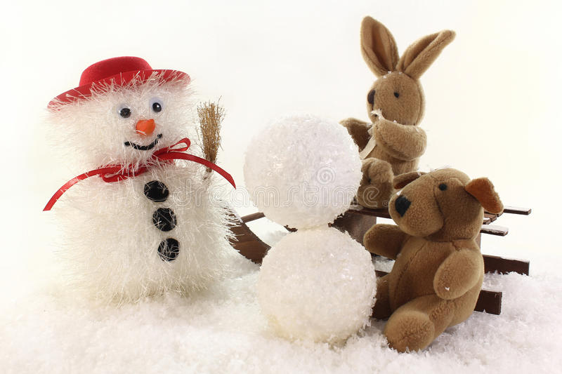 Download Build a snowman stock image. Image of family, sleds, winter - 23363121