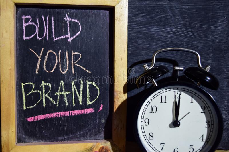Build your brand on phrase colorful handwritten on blackboard stock photos