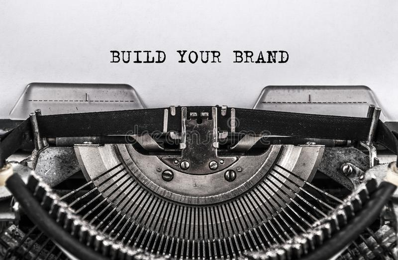 BUILD YOUR BRAND typed words on old vintage typewriter. close up stock photos