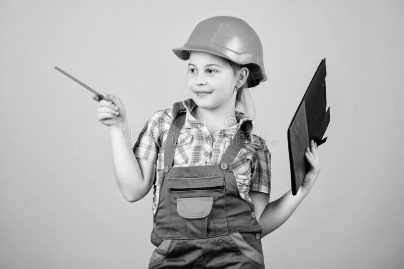 Build your future yourself. Initiative child girl hard hat builder worker. Child care development. Safety expert. Foreman inspector. Builder engineer architect stock photography