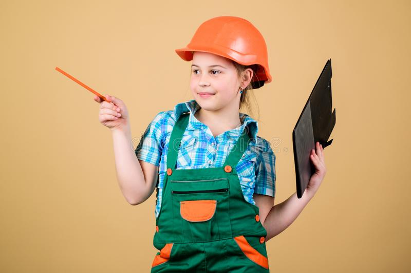 Build your future yourself. Initiative child girl hard hat builder worker. Child care development. Safety expert. Foreman inspector. Builder engineer architect royalty free stock image