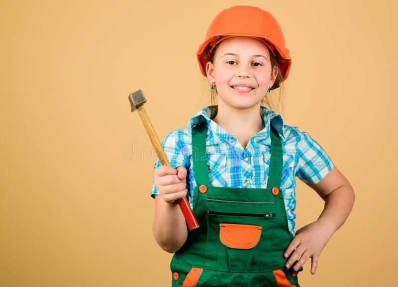 Build your future yourself. Initiative child girl hard hat helmet builder worker. Tools to improve yourself. Child care. Development. Future profession. Builder royalty free stock image