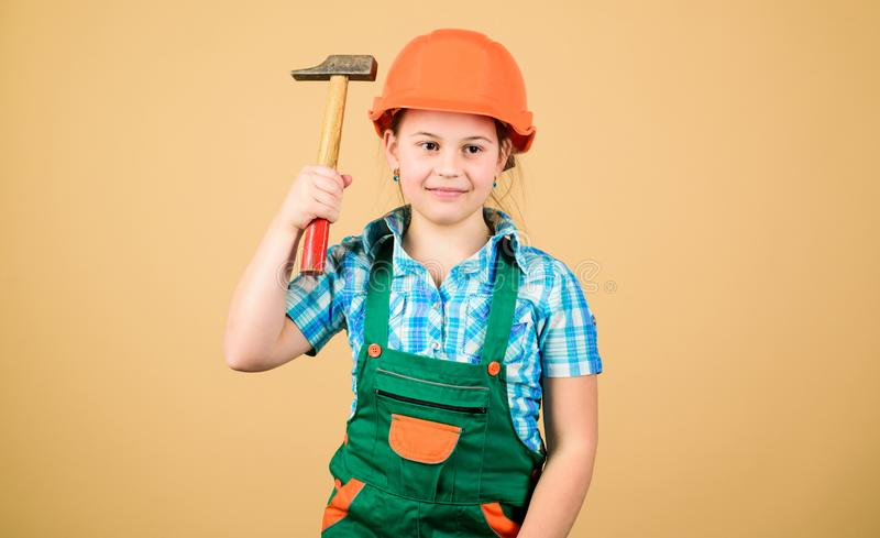 Build your future yourself. Initiative child girl hard hat helmet builder worker. Tools to improve yourself. Child care. Development. Builder engineer architect royalty free stock photos