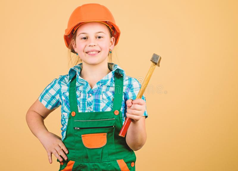 Build your future yourself. Initiative child girl hard hat helmet builder worker. Tools to improve yourself. Child care. Development. Future profession. Builder royalty free stock photo