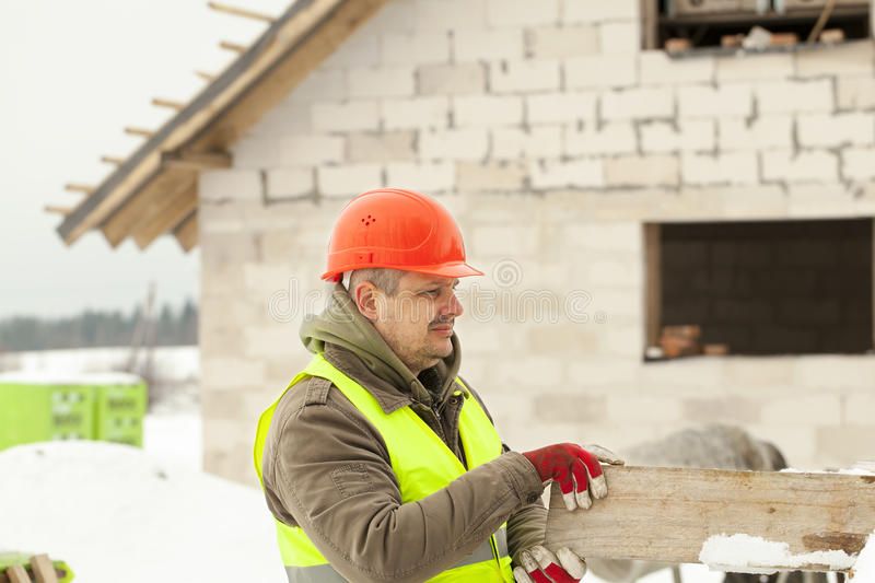 Builder with board at the hands royalty free stock photo