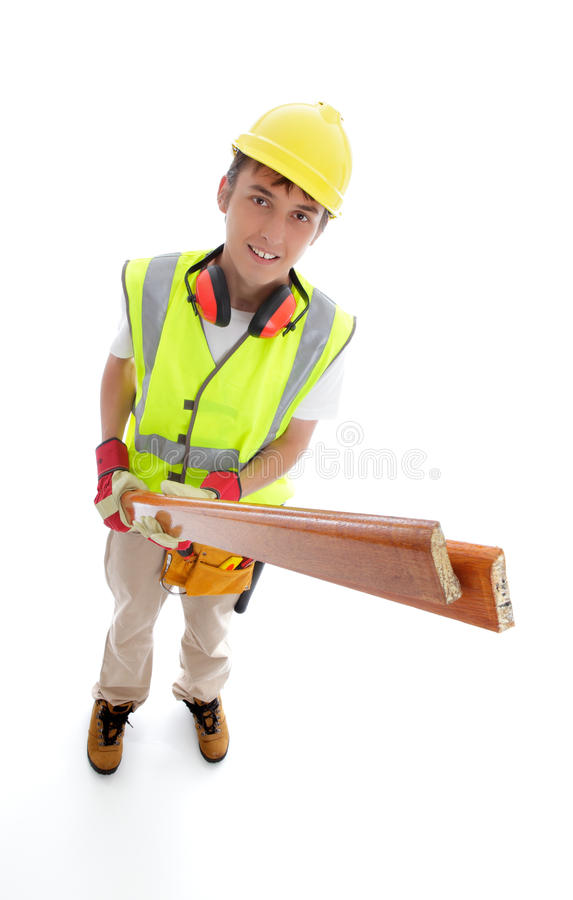 Builder or Carpenter. Young apprentice trainee builder or carpenter holding timber and smiling. White background stock images