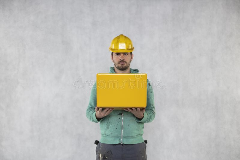 Builder with a computer in his hands royalty free stock photo