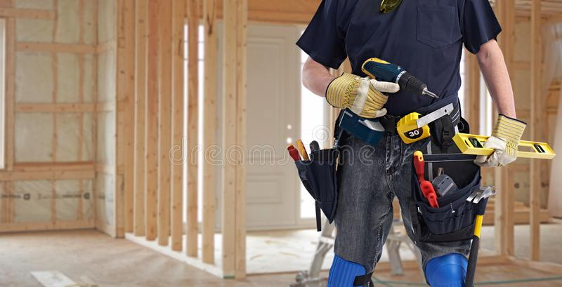 Builder handyman with drill tools. stock photo