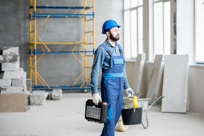 Builder at the construction site royalty free stock photo