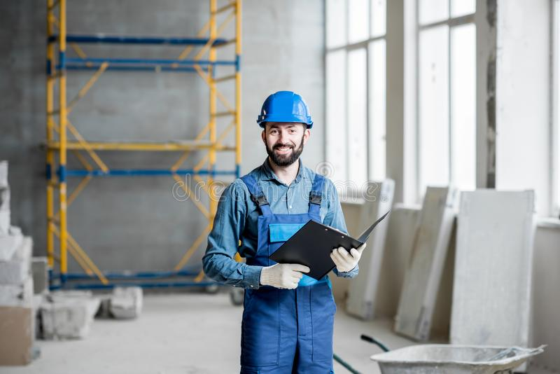 Builder at the construction site royalty free stock image