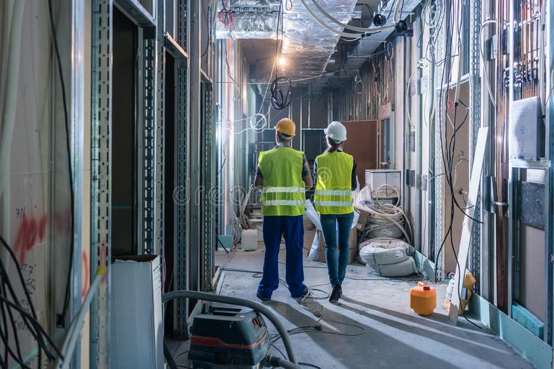 Builder and construction worker inspecting the site royalty free stock photo