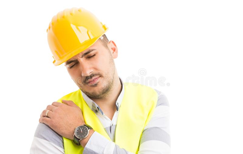 Builder or construction worker suffering shoulder pain problem stock photo