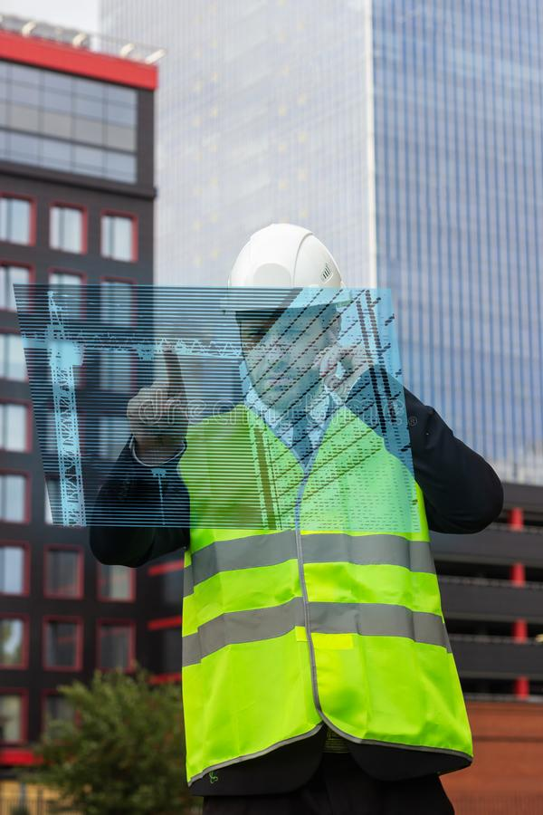 Builder control new technology hologram drawing architecture workman  taskmaster. Check stock images