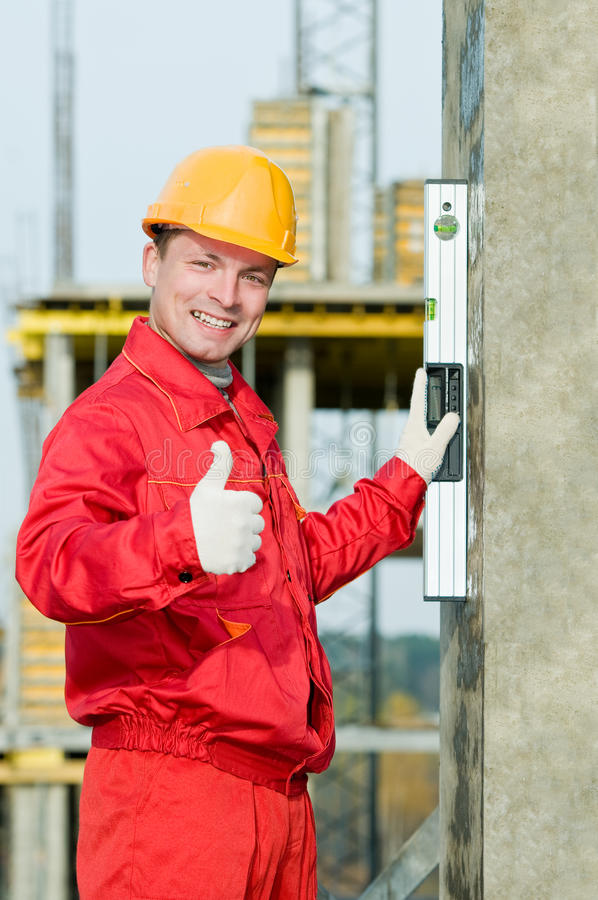 Builder with digital level stock photo
