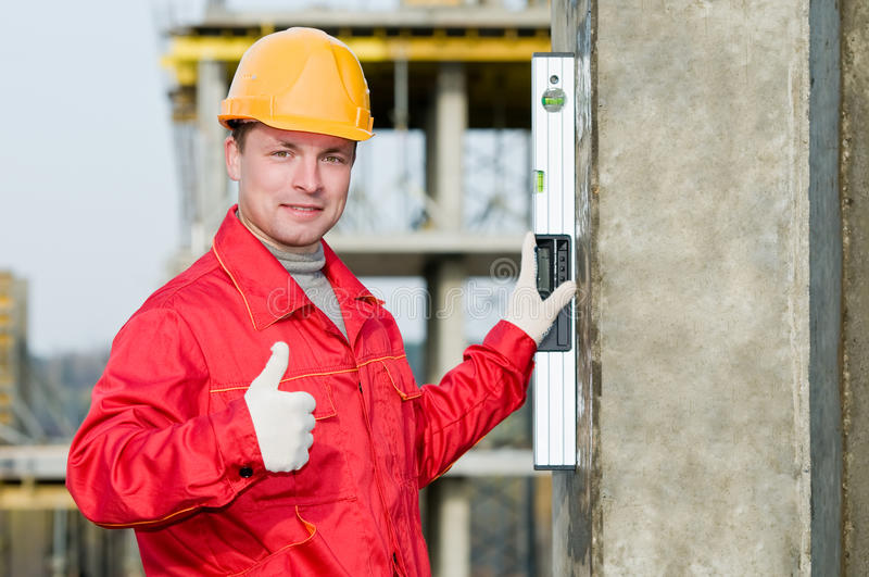 Builder with digital level stock images