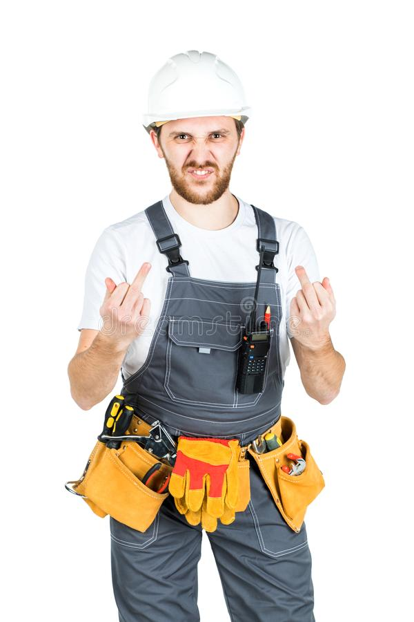 A builder or an employee in a protective helmet shows a hand gesture. Isolated over white background. royalty free stock photography