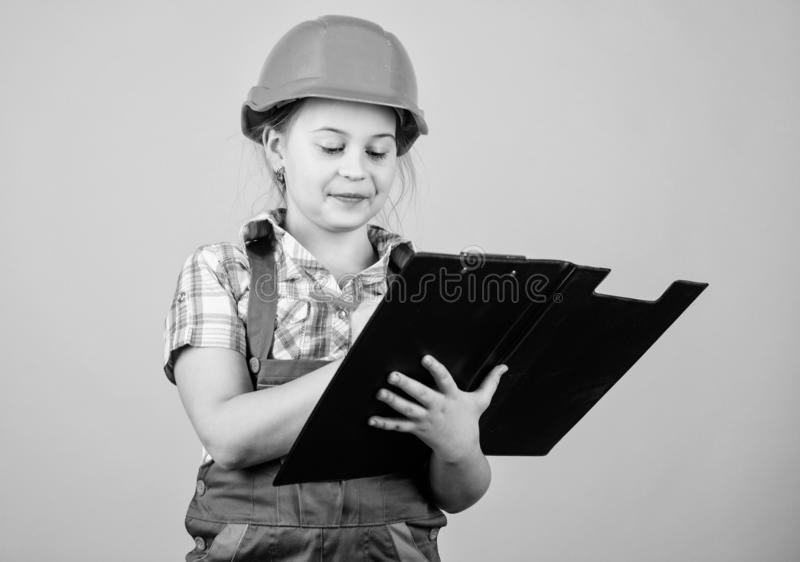 Builder engineer architect. Kid worker in hard hat. Child care development. small girl repairing in workshop. Foreman. Inspector. Repair. Safety expert. Future royalty free stock photography