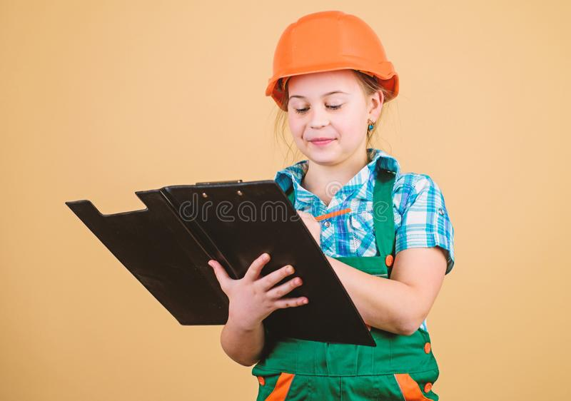Builder engineer architect. Kid worker in hard hat. Child care development. small girl repairing in workshop. Foreman stock images
