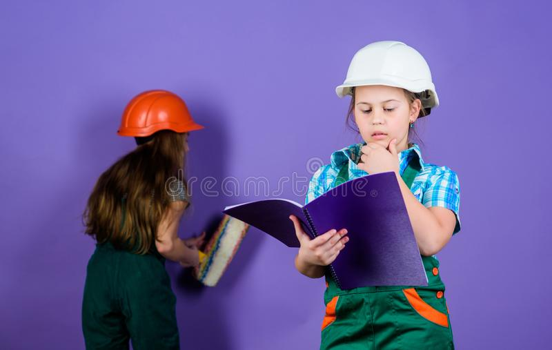 Builder engineer architect. Kid worker in hard hat. Child care development. small girls repairing together in workshop. Tools to improve yourself. Repair stock images
