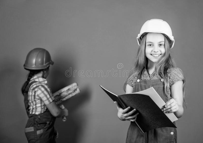Builder engineer architect. Kid worker in hard hat. Future profession. Tools to improve yourself. Repair. Child care. Development. small girls repairing stock images