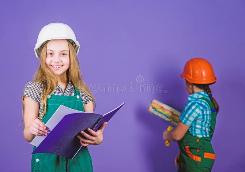 Builder engineer architect. Kid worker in hard hat. Future profession. Tools to improve yourself. Repair. Child care. Development. small girls repairing stock image