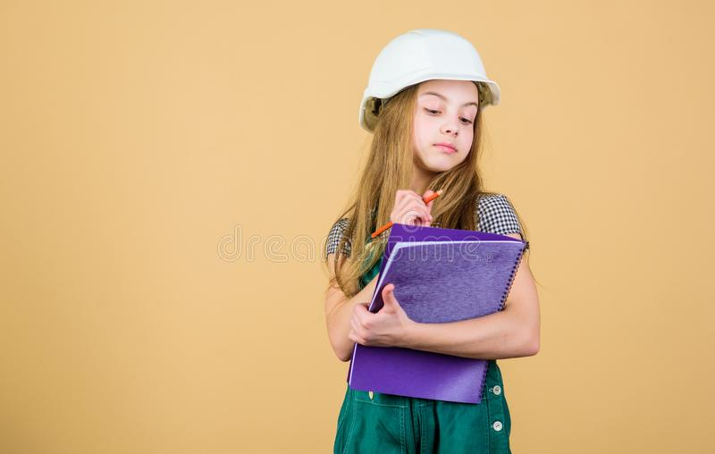 Builder engineer architect. Kid worker in hat. Safety expert. Future profession. Foreman inspector. Repair. Child care. Development. small girl repairing in stock images