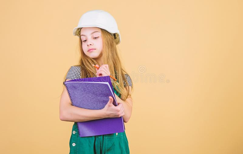 Builder engineer architect. Kid worker in hat. Safety expert. Future profession. Foreman inspector. Repair. Child care. Development. small girl repairing in royalty free stock photos