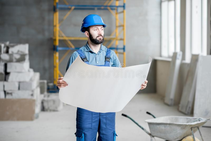 Builder at the construction site royalty free stock images