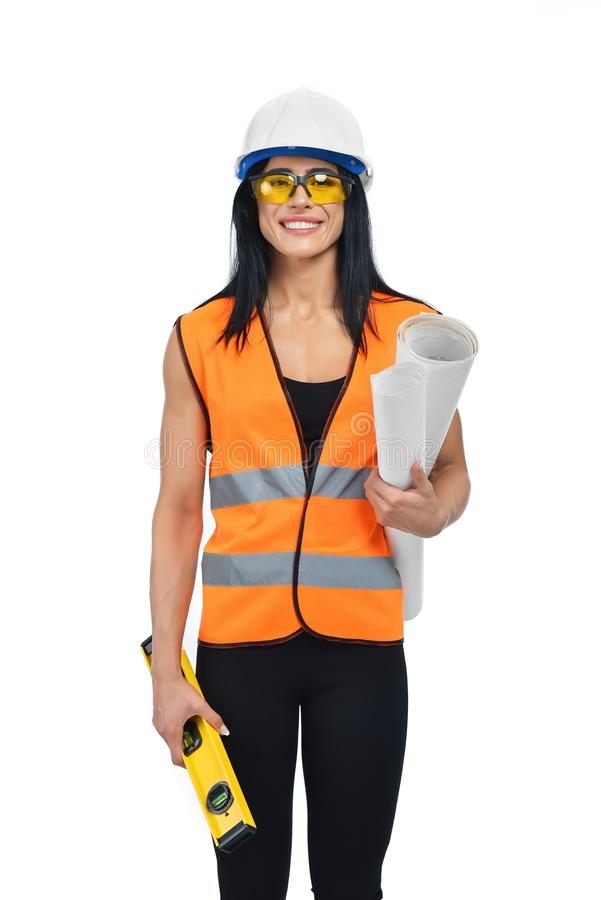 Builder in glasses working at useful and interesting job. stock photo