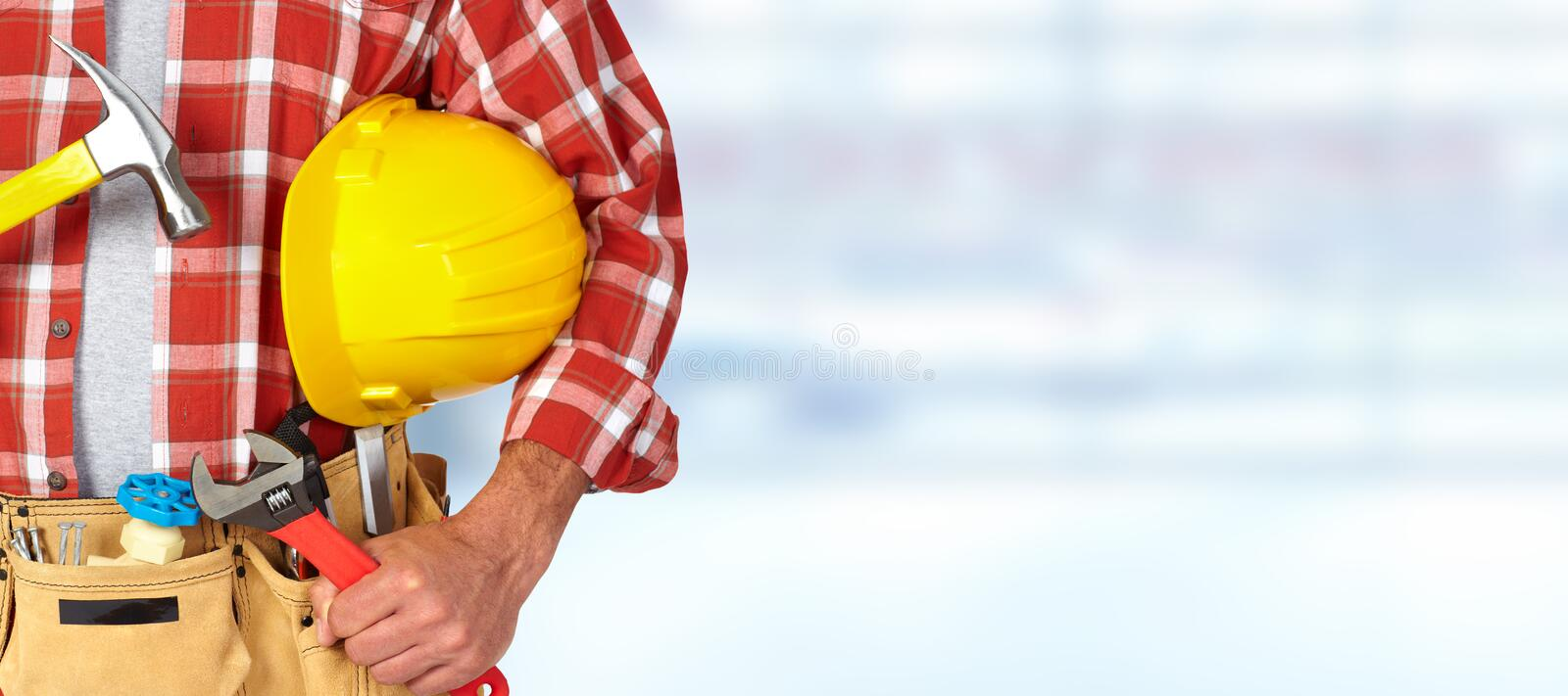 Builder handyman with construction tools. Builder handyman with construction tools on blue background stock images
