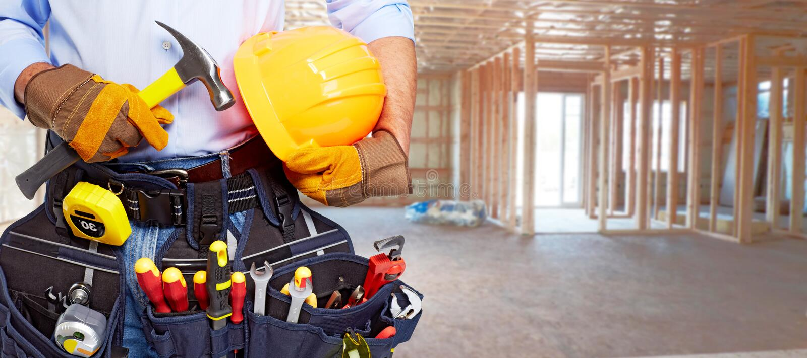 Builder handyman with construction tools. royalty free stock images