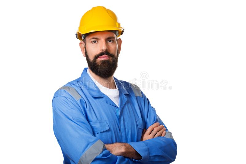 Builder in hard hat, foreman or repairman in the helmet. Bearded man worker with beard in building helmet, isolated stock images