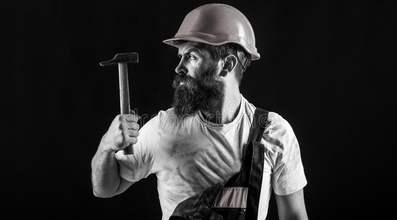 Builder in helmet, hammer, handyman, builders in hardhat. Handyman services. Hammer hammering. industry, technology stock images