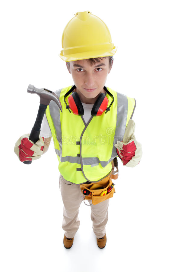 Builder holding hammer thumbs up approval success. Teenage apprentice builder or technical college tranee student holding a hammer and showing thumbs up approval stock photos