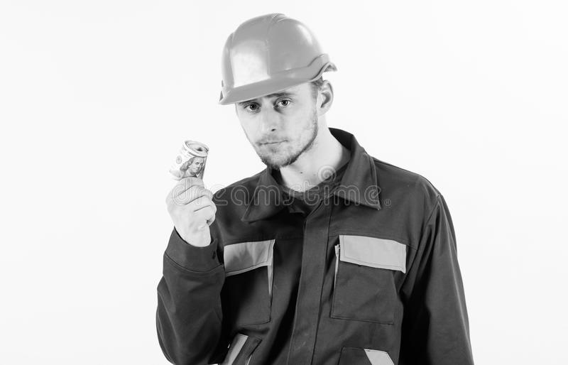 Builder holds salary, cash, money in hand. Construction worker making money or being paid on white background stock photography